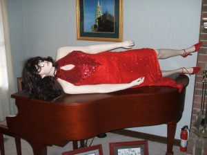 Julie McCoy is a classy lady lounging on the piano.